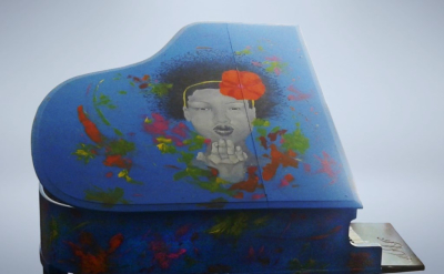 "A Kiss For Peace - Medix media painted over piano - ""Pianos For Peace"" commission"