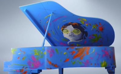 "A Kiss For Peace - Mixed media painted over piano - ""Pianos For Peace"" commission"
